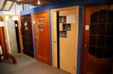 Двери межкомнатные, рулонные шторы, натяжные потолки.
